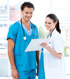 Happy medical partners looking at the diagnosis Royalty Free Stock Photos
