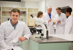 Happy medical student working with microscope Royalty Free Stock Photos