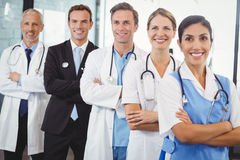 Happy medical team standing with arms crossed Stock Photo