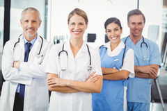 Happy medical team standing with arms crossed Royalty Free Stock Image