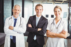 Happy medical team standing with arms crossed Royalty Free Stock Photos