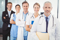 Happy medical team standing with arms crossed Stock Image