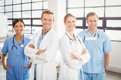 Happy medical team standing with arms crossed. Portrait of happy medical team standing with arms crossed in hospital Stock Photography