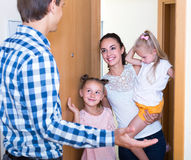 Happy meeting at the doorway Stock Images