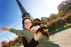 Happy meeting of two women hugging in the street Stock Images