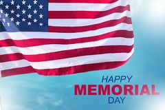 Happy memorial day with american flag waving. Over blue sky background