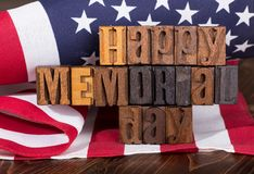 Happy Memorial Day Banner. Happy memorial day wooden text with american flag in background Stock Photos