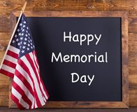 Happy Memorial Day Sign. `Happy Memorial Day` written on a chalkboard next to the American flag Stock Image