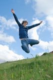 Happy men. Young happy men jumping against summer landscape Royalty Free Stock Image