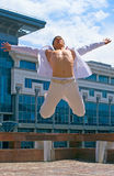 Happy men. Young happy men jumping against urban landscape Stock Photo