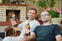 Happy men with beer bottles Stock Image