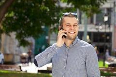 Happy men calling by phone Stock Photos