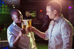 Happy men cheering while watching a football match in bar Royalty Free Stock Photos