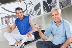 Happy men doing dumbbell training Stock Photo