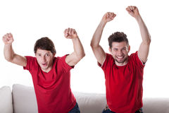 Happy men friends watching match. Happy men friends watching football match at home Stock Images