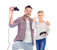 Happy man and his son with video game controllers. Happy men and his son with video game controllers on white background Stock Images