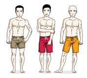 Happy men posing with athletic body, wearing beach shorts. Vecto Stock Images