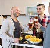 Happy men relaxing with beer Stock Image