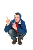 Happy men squatting and pointing fingers Stock Photo