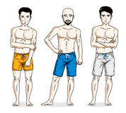 Happy men standing with athletic body, wearing beach shorts. Vec Royalty Free Stock Photography