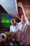 Happy men watching a football match. In bar Stock Images