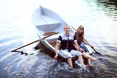 Happy man and woman splashing in water Stock Photography