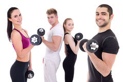 Happy men and women in sportswear doing exercises with dumbbells Stock Images