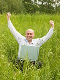 Happy men working on laptop Royalty Free Stock Photos