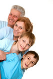 Happy mercy grandparents with grandchildren fooled. On a light background Royalty Free Stock Images