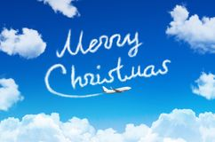 Happy Merry Christmas concept. Drawing by airplane vapor contrail in sky. Happy Merry Christmas concept. Drawing by airplane vapor contrail in sky Royalty Free Stock Image