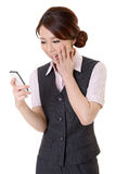 Happy message. Smiling business woman of Asian looking message on mobile phone, closeup portrait on white background Stock Photo