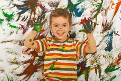 Happy messy boy showing colorful palms Royalty Free Stock Photography