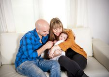 Happy mexican couple cuddling their newborn baby b Royalty Free Stock Photos