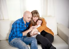 Happy mexican couple cuddling their newborn baby boy Stock Photography
