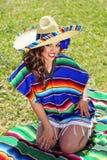 Happy Mexican Senorita at the Park stock photo