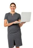 Happy Mid Adult Businesswoman Holding Laptop Stock Photos