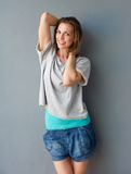 Happy mid adult female smiling with hands in hair Royalty Free Stock Photos