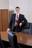 Happy mid-adult Hispanic businessman in boardroom Royalty Free Stock Photo