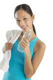 Happy Mid Adult Woman With Towel And Water Bottle Stock Photography