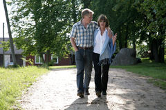 Happy midage couple. Walking in the countryside Royalty Free Stock Photography