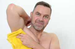 Happy Middle Age Man Drying his armpit with Towel Stock Image