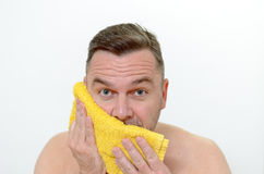 Happy Middle Age Man Drying his cheek with Towel Stock Photo