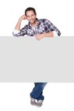 Happy middle age man presenting empty banner. Isolated on white Royalty Free Stock Photography