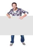 Happy middle age man presenting empty banner. Isolated on white Royalty Free Stock Photos