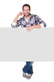 Happy middle age man presenting empty banner. Isolated on white Stock Images