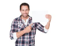 Happy middle age man presenting empty paper Stock Photography
