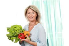 Middle age woman with healthy vegetables. Happy middle age woman with healthy vegetables Royalty Free Stock Photography