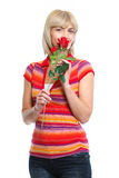 Happy middle age woman smelling red rose Royalty Free Stock Photo