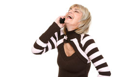 Happy middle age woman talking by phone Royalty Free Stock Image