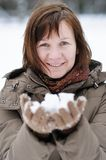 Happy middle age woman in winter Royalty Free Stock Photos